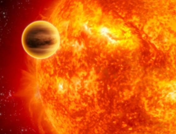 WASP-12b на орбите вокруг своей звезды. Иллюстрация ESA/C Carreau