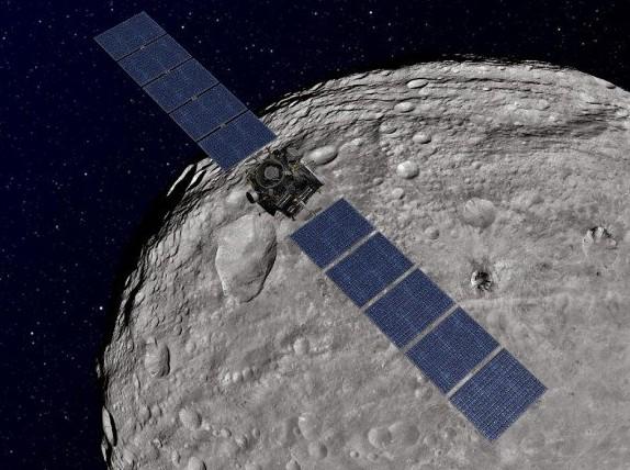 «Dawn» на орбите Весты. Иллюстрация NASA / JPL-Caltech