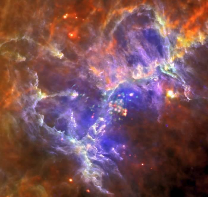 Туманность Орла в рентгеновском и инфракрасном диапазоне. Фото ESA/Herschel/PACS/SPIRE/Hill, Motte, HOBYS Key Programme Consortium; X-ray: ESA/XMM-Newton/EPIC/XMM-Newton-SOC/Boulanger