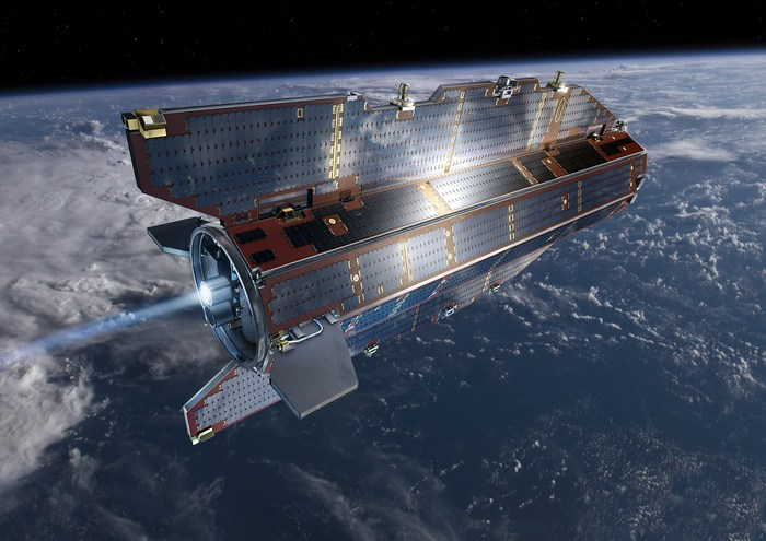 Спутник GOCE на орбите Земли в представлении художника.
