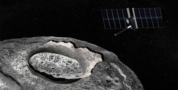 """Концепция художника, """"Космический корабль изучает огромный металлический астероид Психея с орбиты""""."""