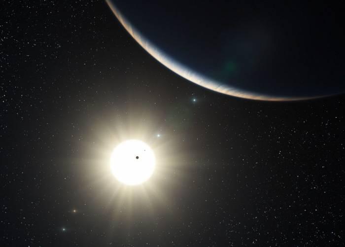 Система звезды HD 10180 глазами художника. Иллюстрация ESO/L. Calcada